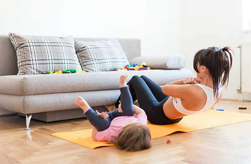 April health and wellness month - mom and toddler exercising