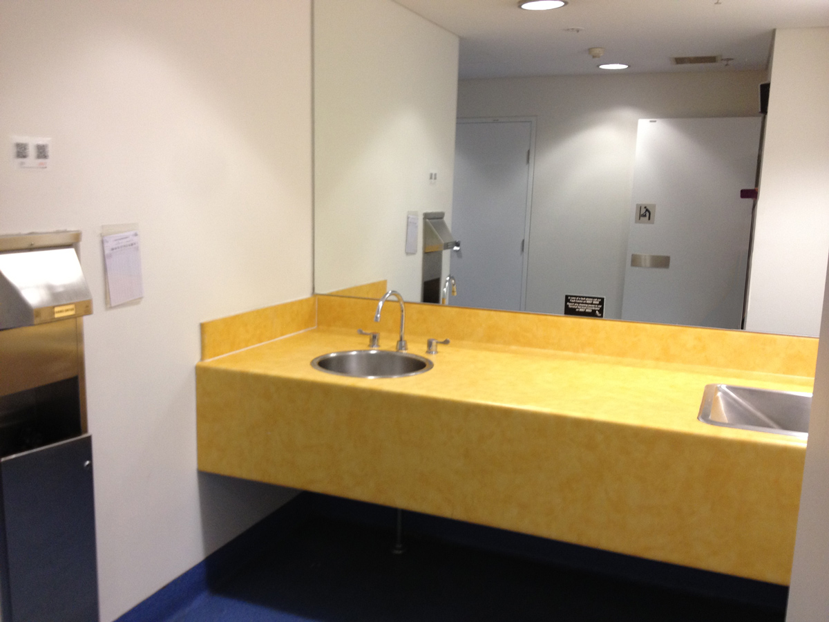 Photo of Sydney Airport parents room sink counter top changing table.
